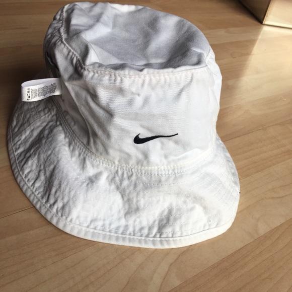 4203fea41baf9 Nike Reversible Bucket Beach Hat Cap. M 5b2ee7a745c8b3efdf266574. Other  Accessories ...